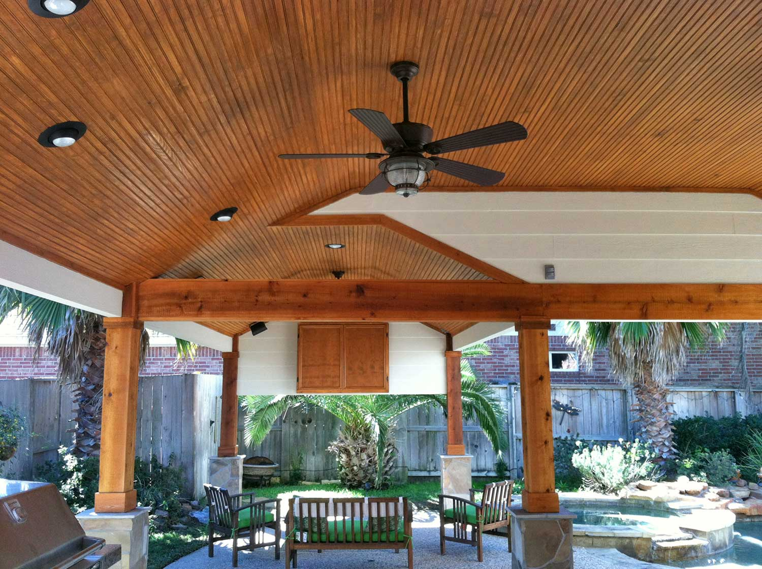patio cover with wood columns and outdoor kitchen - hhi patio covers