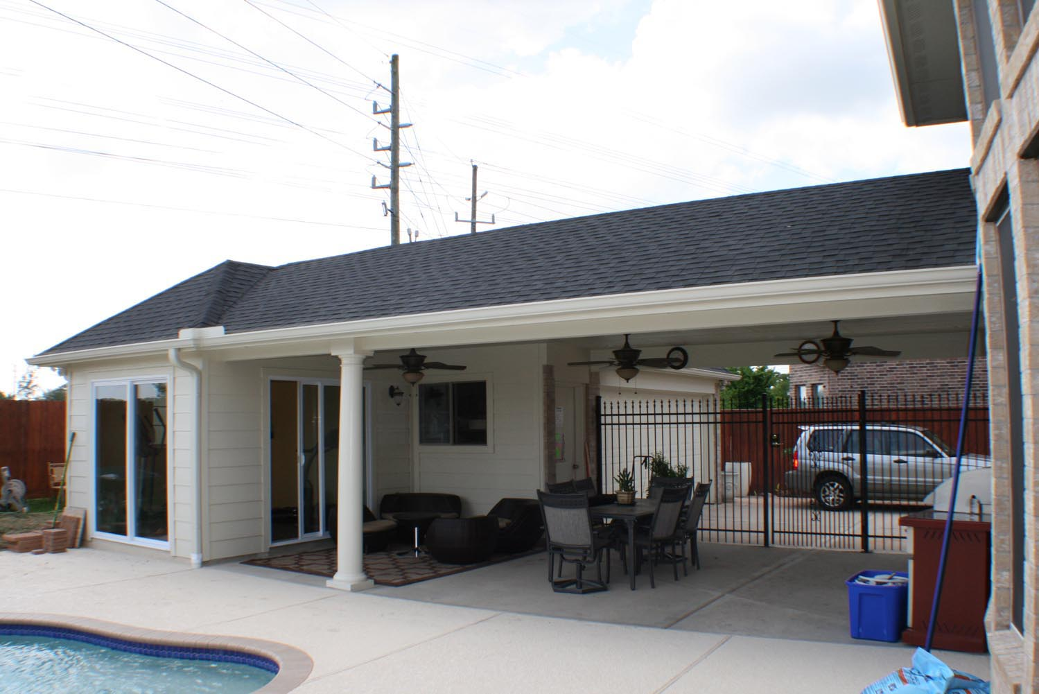 Patio cover plus exercise room hhi patio covers for Pictures plus houston